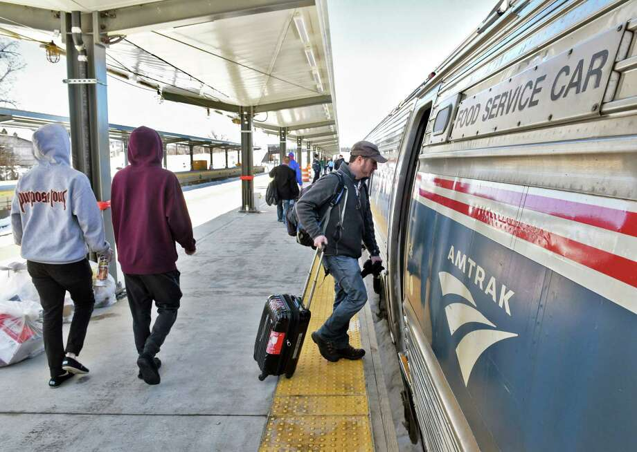 Passengers on the newly extended station platform board the Lake Shore Limited at the Rensselaer Amtrak station Friday March 17, 2017, in Rensselaer, N.Y.  (John Carl D'Annibale / Times Union) Photo: John Carl D'Annibale / 20039980A