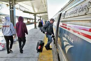 Passengers on the newly extended station platform board the Lake Shore Limited at the Rensselaer Amtrak station Friday March 17, 2017, in Rensselaer, N.Y.  (John Carl D'Annibale / Times Union)