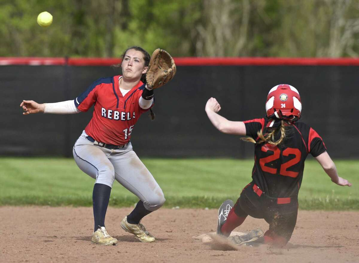 Pomperaug's Hailey Latta (22) slides safely into second while New Fairfield's Dana Giardina (15) waits fro the throw in the girls softball game between New Fairfield and Pomperaug high schools on Friday, May 12, 2017, at Pomperaug High School, in Southbury, Conn.