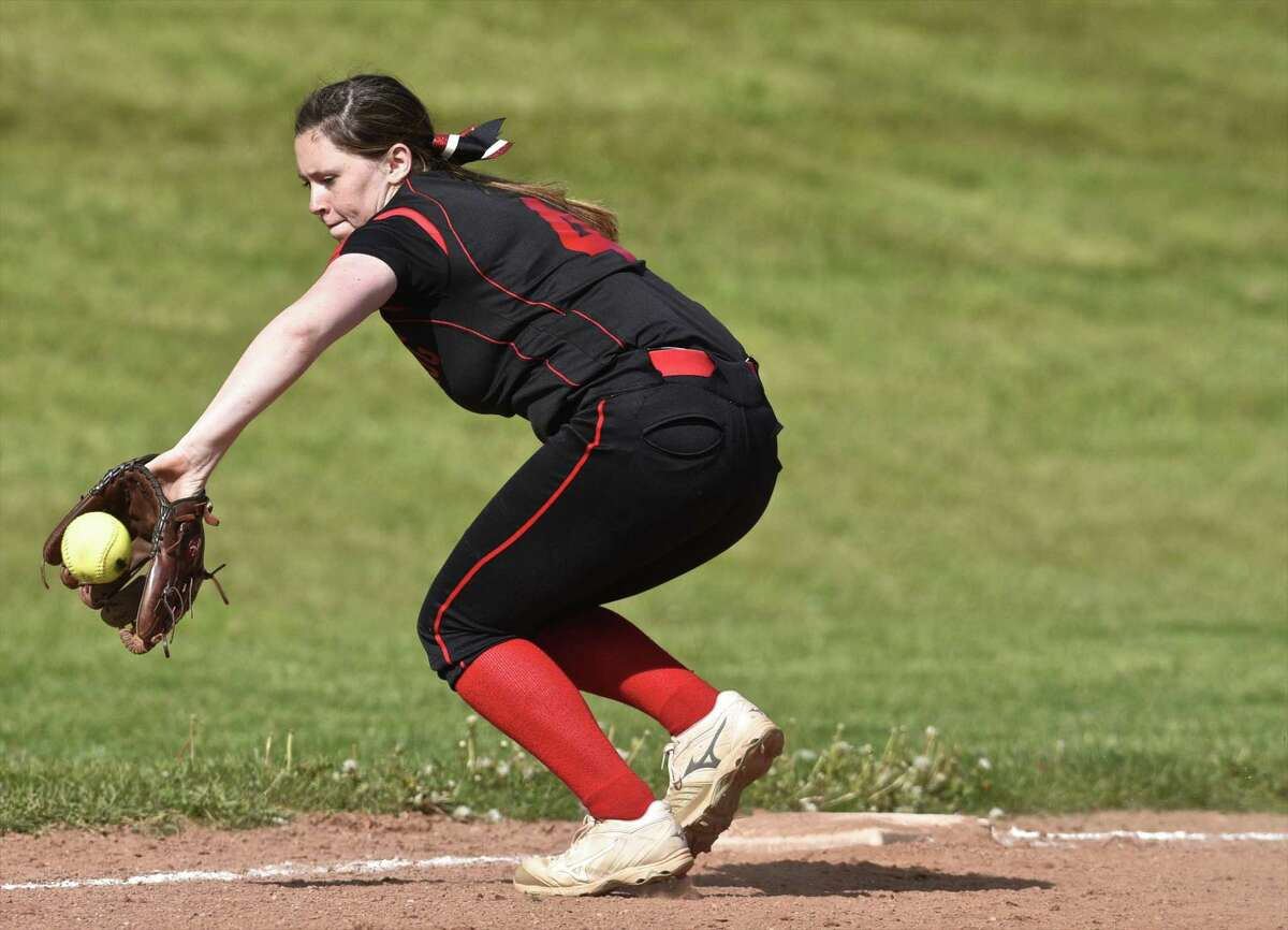 Pomperaug's Laurel Williams (4) back hands a ground ball hit down the thrird baseline in the girls softball game between New Fairfield and Pomperaug high schools on Friday, May 12, 2017, at Pomperaug High School, in Southbury, Conn.