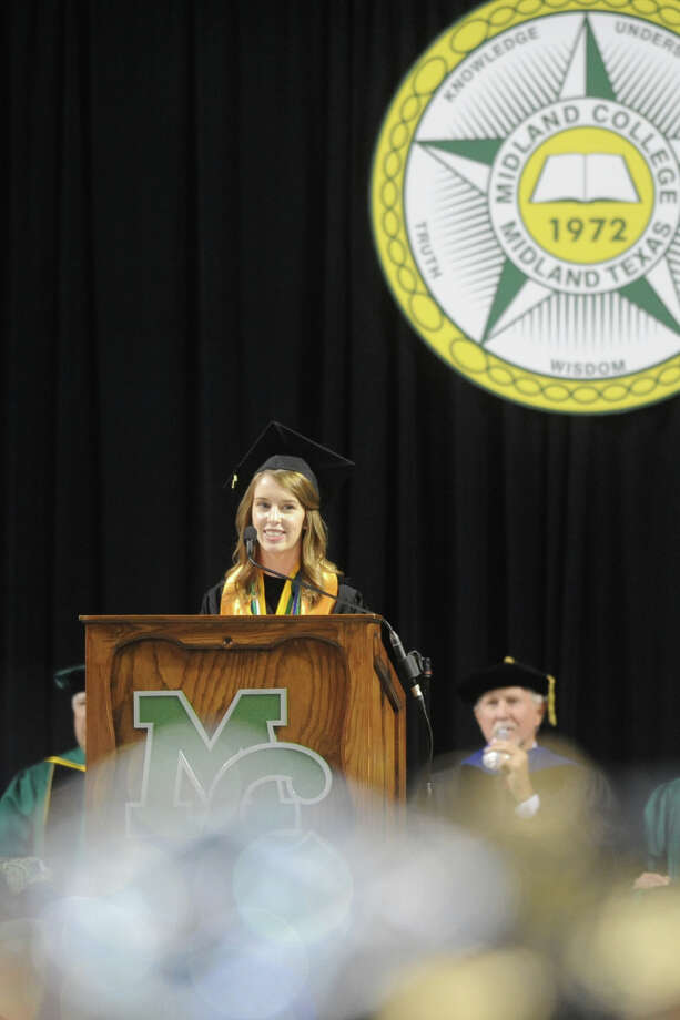 Commencement speaker Lauren Bell walks the stage during the Midland College graduation ceremony May 12, 2017, at Chaparral Center. Bell graduated from Texas Tech University in May and works at Midland Children's Rehabilitation Center. Photo: James Durbin