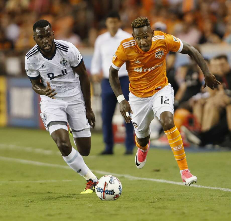Vancouver Whitecaps midfielder Tony Tchani (16) defends Houston Dynamo forward Romell Quioto (12) in the first half during the MLS game between the Houston Dynamo and the Vancouver Whitecaps at BBVA Compass Stadium on Friday, May 12, 2017, in Houston, TX. Photo: Tim Warner/For The Chronicle