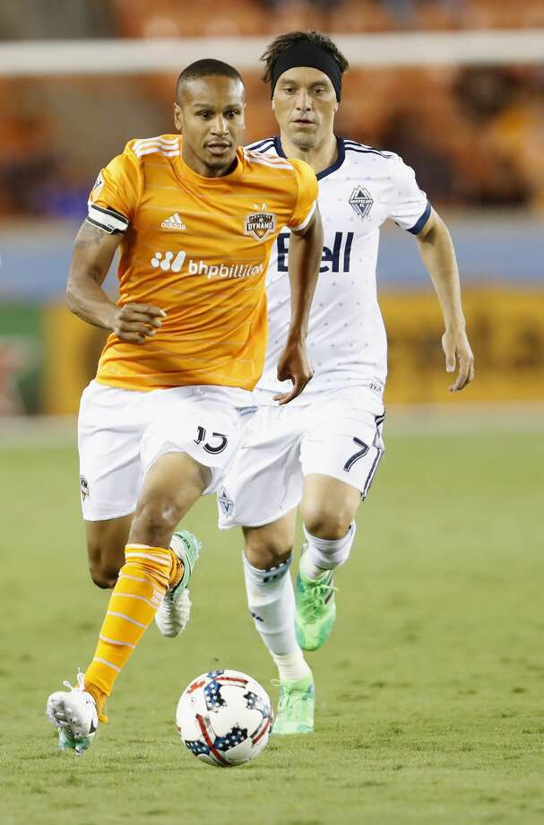 Houston Dynamo midfielder Ricardo Clark (13) controls the ball defended by Vancouver Whitecaps midfielder Christian Bolanos (7) in the second half during the MLS game between the Houston Dynamo and the Vancouver Whitecaps at BBVA Compass Stadium on Friday, May 12, 2017, in Houston, TX. Photo: Tim Warner/For The Chronicle