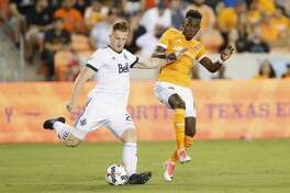 Houston Dynamo forward Alberth Elis (17) battles with Vancouver Whitecaps midfielder Sheanon Williams (25) for the ball in the first half during the MLS game between the Houston Dynamo and the Vancouver Whitecaps at BBVA Compass Stadium on Friday, May 12, 2017, in Houston, TX.