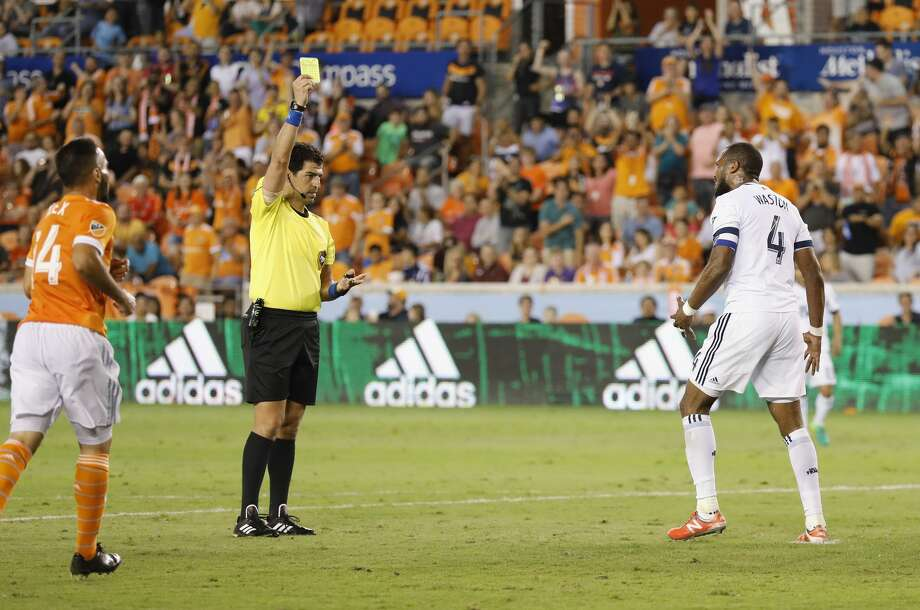 Vancouver Whitecaps defender Kendall Watson (4) reacts to a yellow card in the second half during the MLS game between the Houston Dynamo and the Vancouver Whitecaps at BBVA Compass Stadium on Friday, May 12, 2017, in Houston, TX. Photo: Tim Warner/For The Chronicle