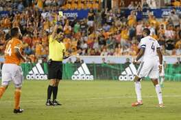 Vancouver Whitecaps defender Kendall Watson (4) reacts to a yellow card in the second half during the MLS game between the Houston Dynamo and the Vancouver Whitecaps at BBVA Compass Stadium on Friday, May 12, 2017, in Houston, TX.