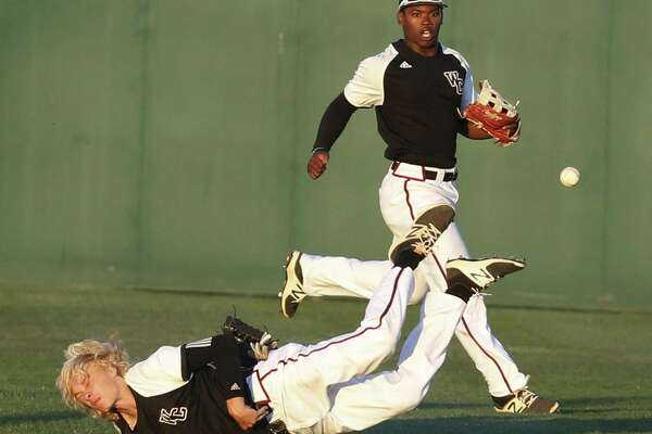 Churchill right fielder Hudson Head dives but misses a catch in the fourth inning as teammate Jordan Billups backs him up on the play against Clemens during a second round Class 6A playoff game at Blossom Athletic Center on May 12, 2017.