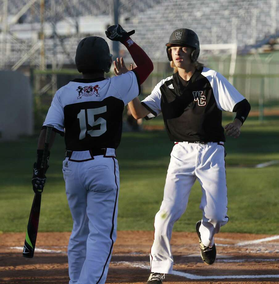 Churchill's Hudson Head (right) is congratulated after a scoring a run in the first inning against Clemens during the second round of a Class 6A baseball playoff game at Blossom Athletic Center on May 12, 2017. Photo: Kin Man Hui /San Antonio Express-News / ©2017 San Antonio Express-News