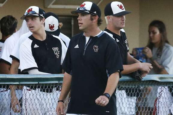 Churchill coach Alan Hill talks to his team in the dugout during their game against Clemens in the second round of Class 6A baseball playoffs at Blossom Athletic Center on May 12, 2017.
