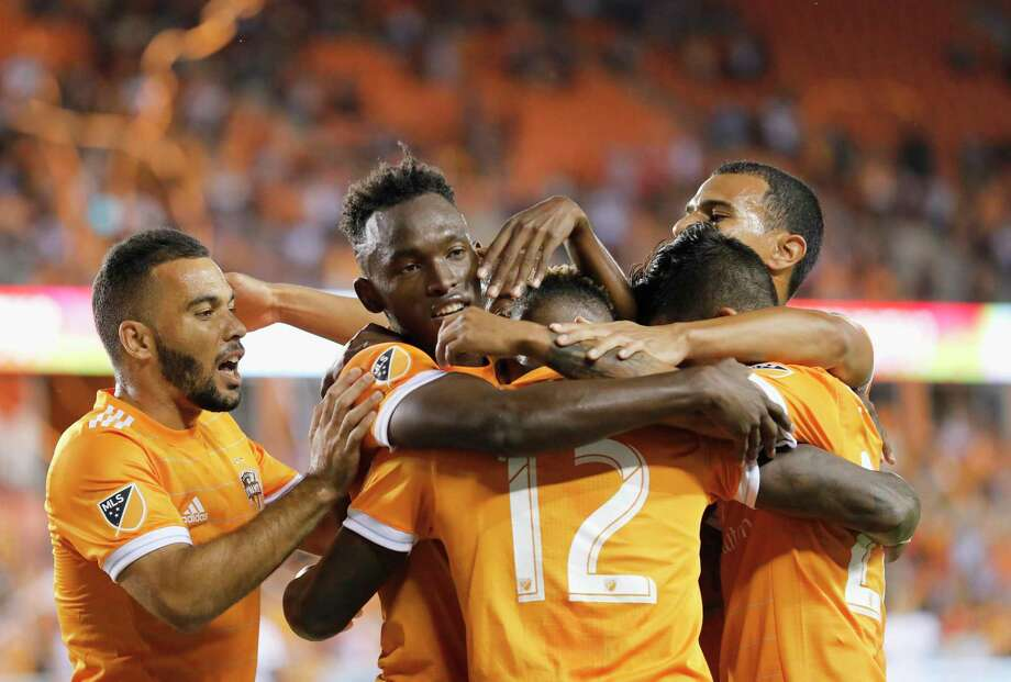 Dynamo forward Alberth Elis, second from left, celebrates after scoring in the first half Friday night.  Photo: Tim Warner, Freelance / Houston Chronicle