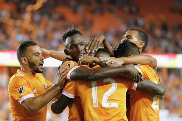 Dynamo forward Alberth Elis, second from left, celebrates after scoring in the first half Friday night.