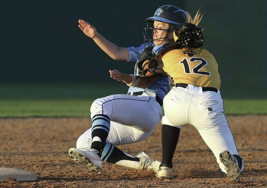 Johnson's Brianna Wodtke is put out trying to steal second as Gabriella Torres swings the pick off throw around during Game 2 of Brennan's Class 6A third-round victory over Johnson Friday. Photo: Tom Reel / San Antonio Express-News / 2017 SAN ANTONIO EXPRESS-NEWS
