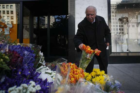 Al Nalbandian, 91, who has been running a flower stand at stockton and geary for 66 years, works in his usual spot on Friday March 22, 2013 in San Francisco, Calif.