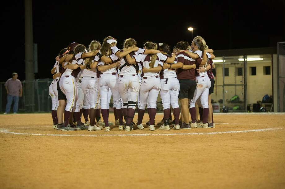 Deer Park players and coaches gather on the pitchers circle after defeating Kingwood in the high school softball playoff game 3 between Kingwood vs Deer Park at Doll Field, Friday, May 12, 2017, in Houston. Deer Park defeated Kingwood 4-2. (Juan DeLeon/for the Houston Chronicle ) Photo: Juan DeLeon/For The Chronicle