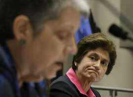 State Auditor Elaine Howle, right, looks over at University of California President Jane Napolitano reads her statement concerning the audit conducted by Howle's office, during a hearing of the Joint Legislative Audit Committee, Tuesday, May 2, 2017, in Sacramento, Calif. Lawmakers questioned Napolitano about the audit that found that UC administrators hid $175 million from the public while the university system raised tuition and asked lawmakers for more money. Napolitano has disputed the audit's findings.(AP Photo/Rich Pedroncelli)