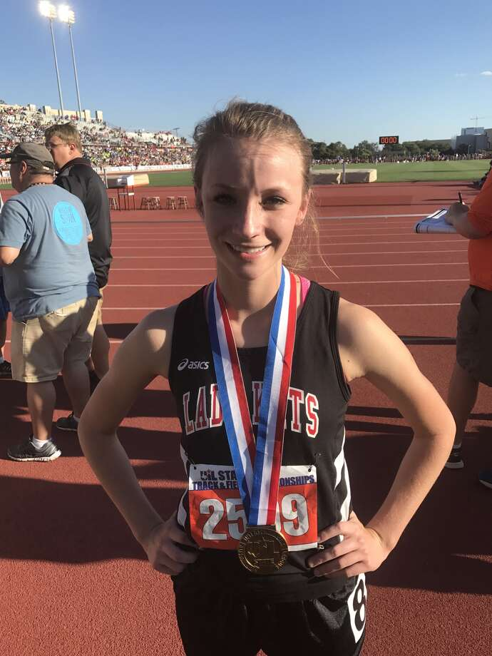 Garden City's Kenzie Shaefer poses after capturing bronze in the Girls 1A 800 meters on Friday in Austin.