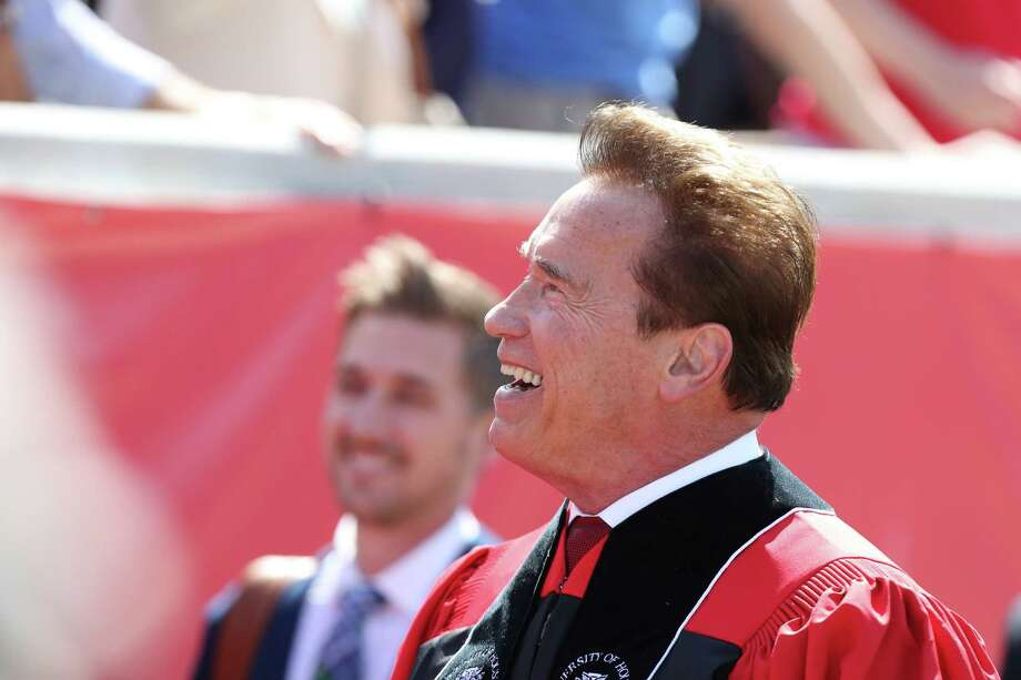 Actor, businessman, bodybuilder and former California Governor Arnold Schwarzenegger enters TDECU Stadium to deliver the University of Houston-wide commencement address Friday, May 12, 2017, in Houston. Photo: Steve Gonzales, Houston Chronicle / © 2017 Houston Chronicle