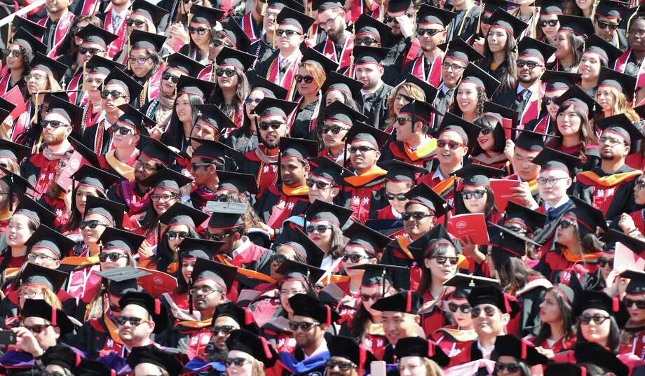 Graduates are seated in TDECU Stadium for a University of Houston-wide commencement  Friday, May 12, 2017, in Houston. Photo: Steve Gonzales, Houston Chronicle / © 2017 Houston Chronicle
