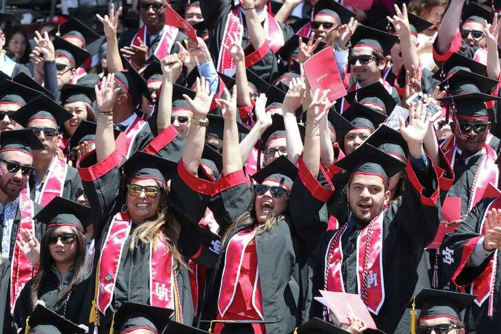 Graduates cheer as their schools are announced in TDECU Stadium for a University of Houston-wide commencement  Friday, May 12, 2017, in Houston.
