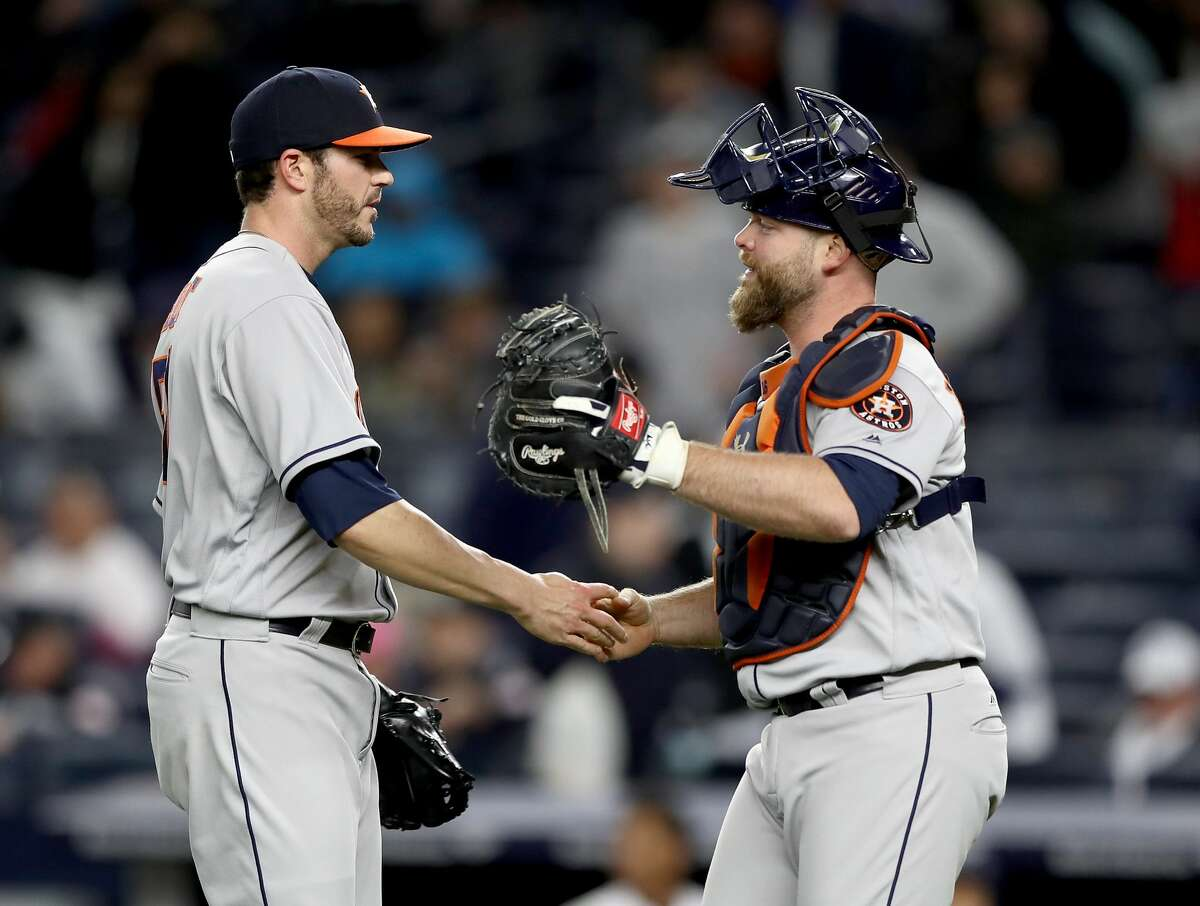 NEW YORK, NY - MAY 12: James Hoyt #51 and Brian McCann #16 of the Houston Astros celebrate the 5-1 win over the New York Yankees on May 12, 2017 at Yankee Stadium in the Bronx borough of New York City. (Photo by Elsa/Getty Images)