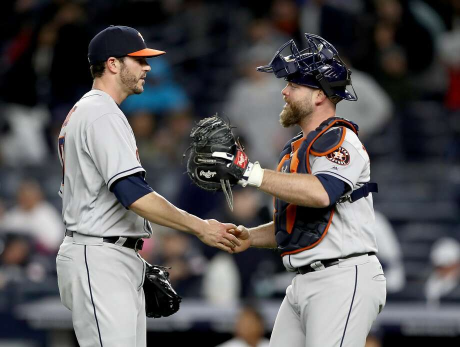 NEW YORK, NY - MAY 12:  James Hoyt #51 and Brian McCann #16 of the Houston Astros celebrate the 5-1 win over the New York Yankees on May 12, 2017 at Yankee Stadium in the Bronx borough of New York City.  (Photo by Elsa/Getty Images) Photo: Elsa/Getty Images
