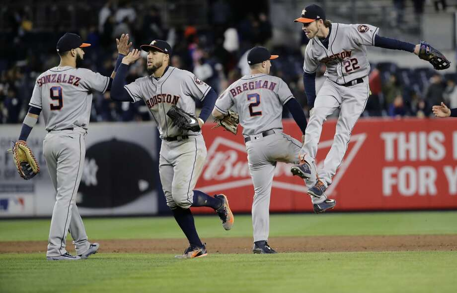 Houston Astros' Marwin Gonzalez (9), George Springer, Alex Bregman (2) and Josh Reddick (22) celebrate after the team's baseball game against the New York Yankees on Friday, May 12, 2017, in New York. The Astros won 5-1. (AP Photo/Frank Franklin II) Photo: Frank Franklin II/Associated Press