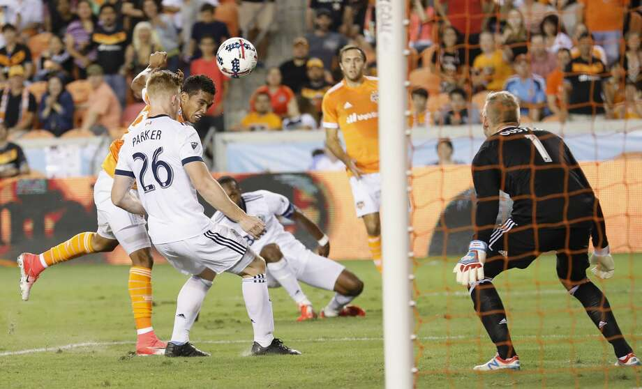 Houston Dynamo forward Mauro Manotas (19) takes a shot on goal defended by Vancouver Whitecaps defender Tim Parker (26) and goalkeeper David Ousted (1) in the second half during the MLS game between the Houston Dynamo and the Vancouver Whitecaps at BBVA Compass Stadium on Friday, May 12, 2017, in Houston, TX. Photo: Tim Warner/For The Chronicle