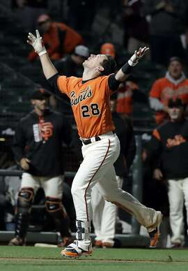 San Francisco Giants' Buster Posey celebrates after hitting a solo walk-off home run against the Cincinnati Reds during the 17th inning of a baseball game Saturday, May 13, 2017, in San Francisco. San Francisco won 3-2. (AP Photo/Marcio Jose Sanchez)