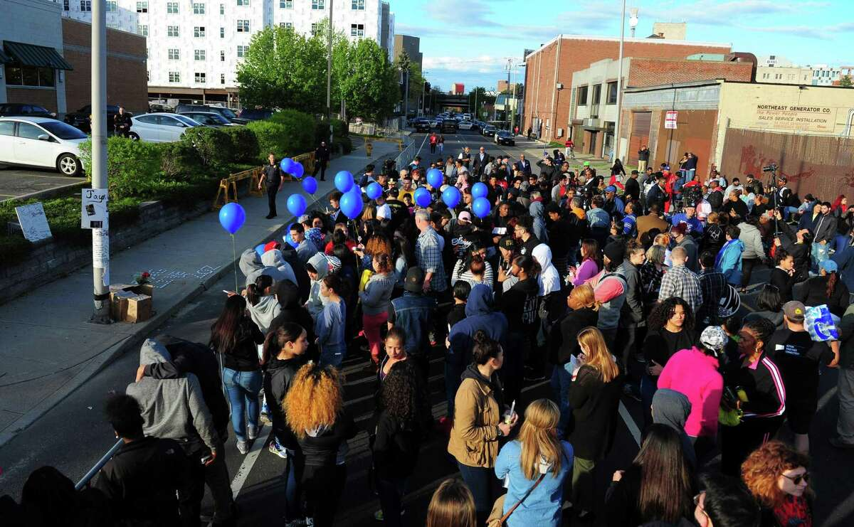 Hundreds of people gather to attend a protest and vigil for Jayson Negron on John Street near the intersection with Park Avenue on Wednesday May 10, 2017. The event, which was organized by CTCORE (Community Organizing for Racial Justice) in New Haven. On Tuesday police were pursuing a stolen car along Laurel and Park avenues at about 5 p.m. before shots were fired and a man, identified as Negron, was killed by a Bridgeport police officer.
