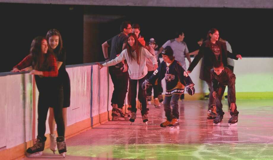 Children enjoy an ice skating session during the Laredo Energy Arena's Holiday Skate event on Saturday afternoon. Photo: Victor Strife, Photographer / LAREDO MORNING TIMES