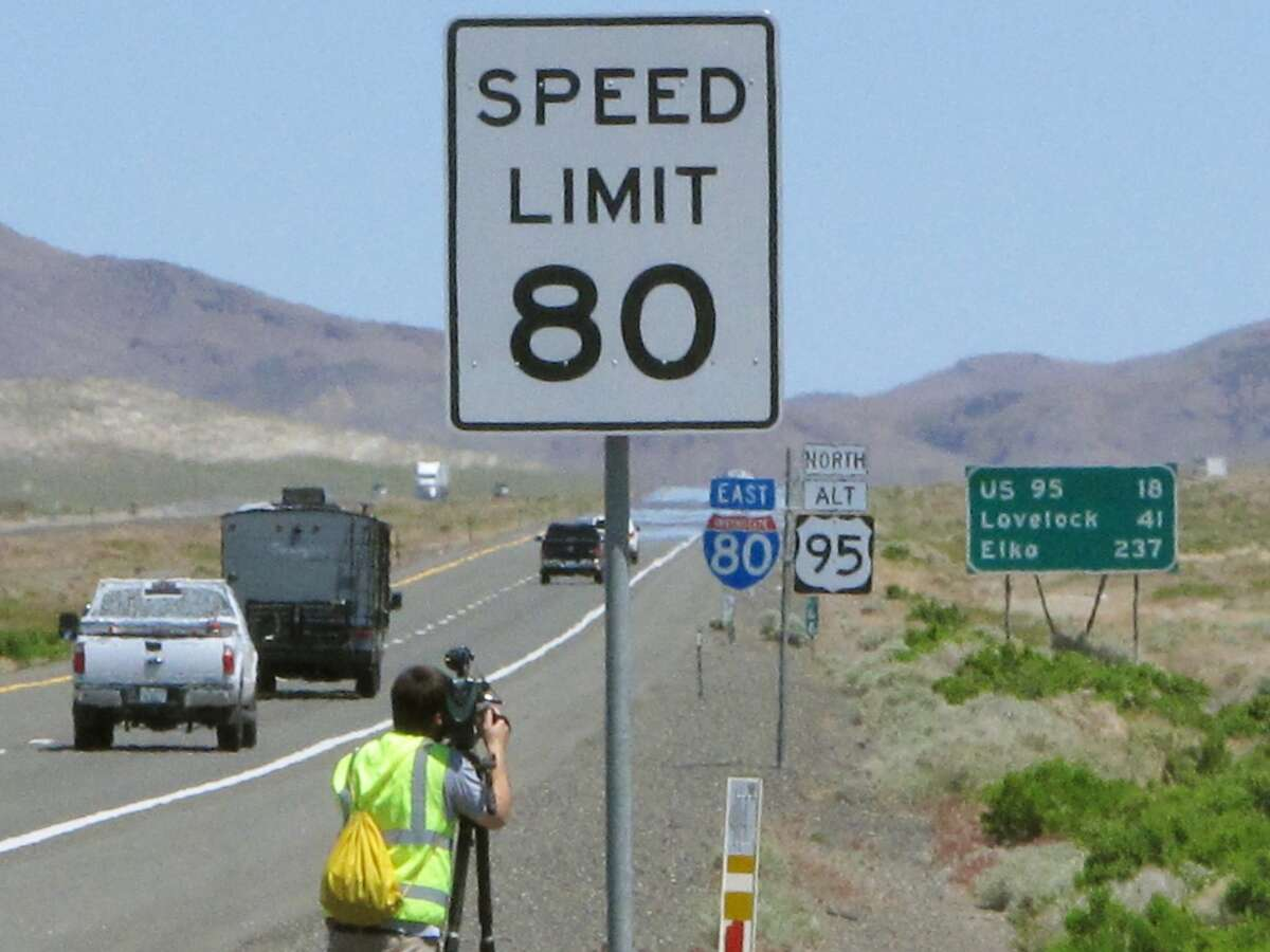 One of the new 80 mph speed limit signs posted Monday, May 8, 2017, along U.S. Interstate 80 east near Fernley, Nev., signals the faster speed allowed on a 130-mile stretch from east of Reno to the rural town of Winnemucca. Nevada joins South Dakota, Wyoming, Montana, Idaho, Utah and Texas as the only states that now allow speeds in excess of 75 mph on parts of rural highways and interstates. (AP Photo/Scott Sonner)