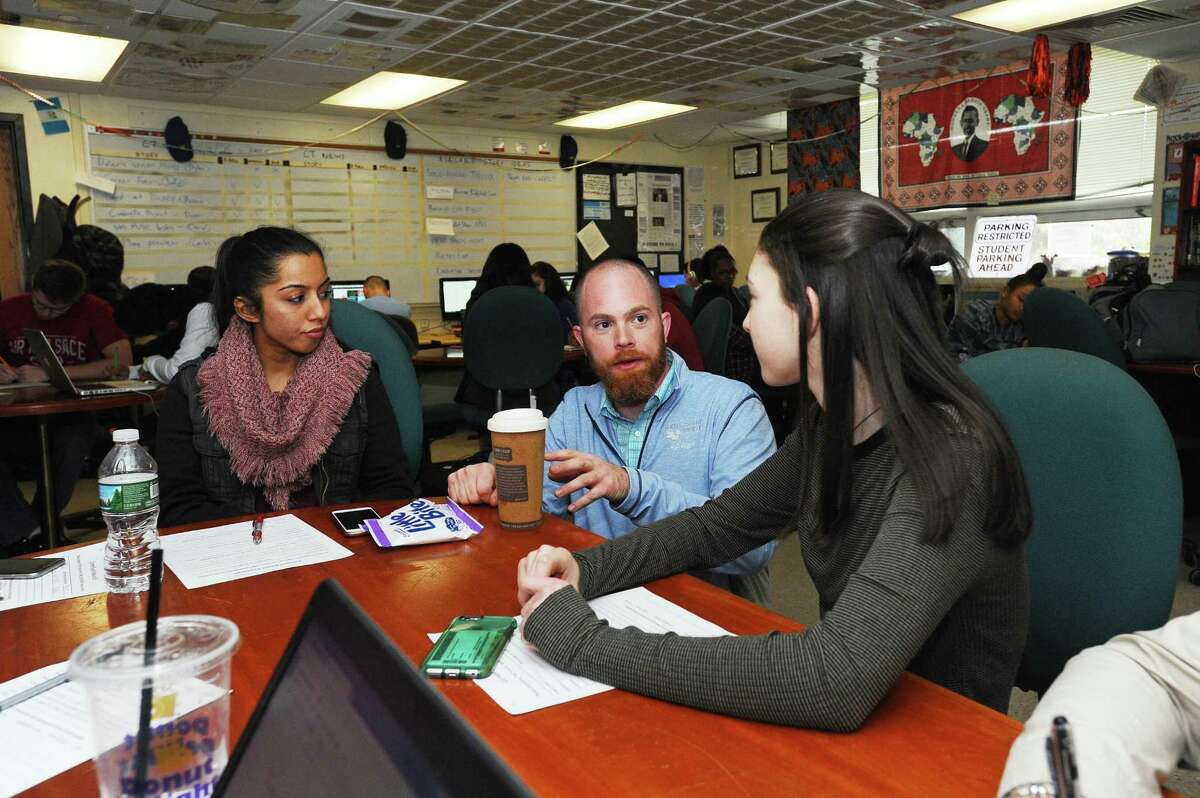 Round Table advisor John Ringel talks with students about recent news during a class inside Stamford High School in Stamford, Conn. on Monday, April 24, 2017.
