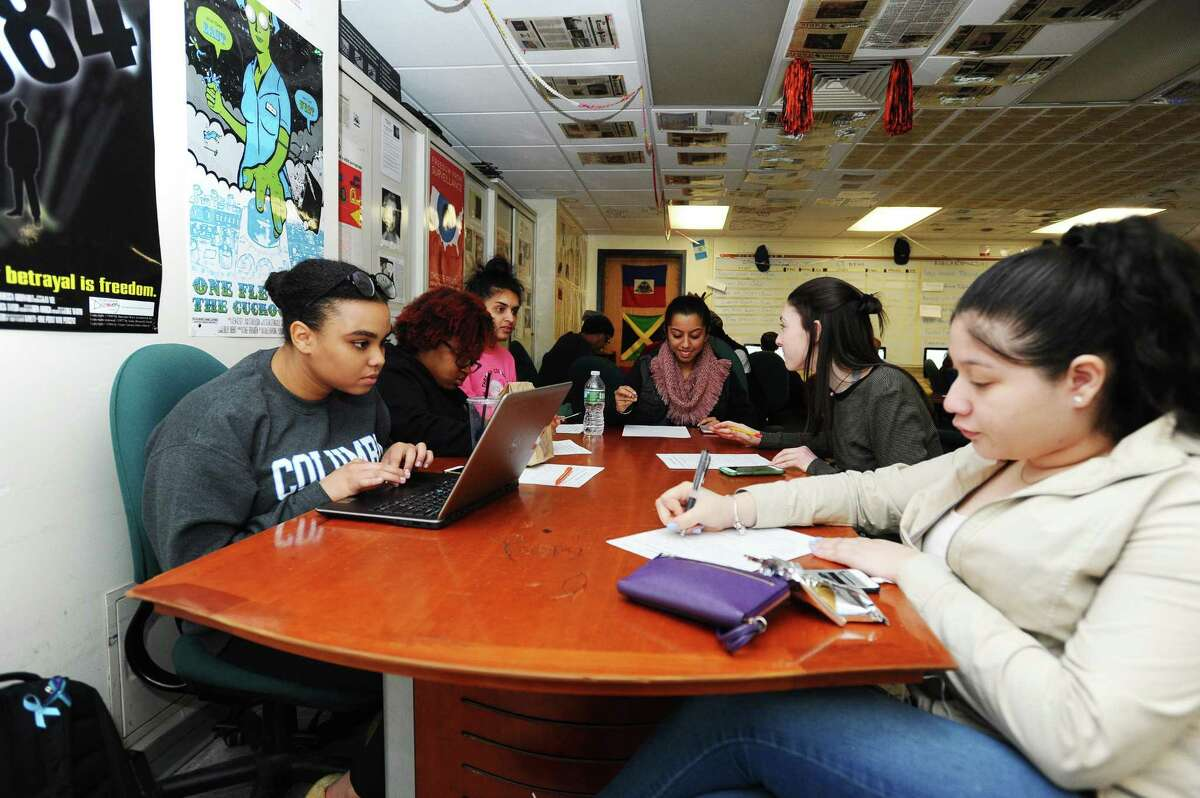 16-year old Mileena Donawa, left, scrolls through news websites during a Round Table class inside Stamford High School in Stamford, Conn. on Monday, April 24, 2017.
