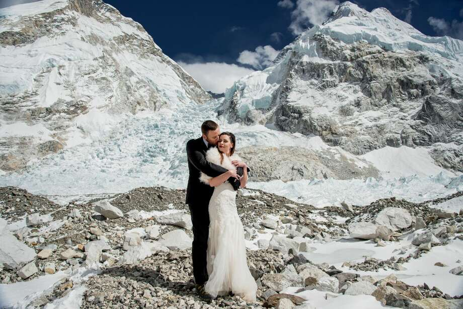 Sacramento couple James Sissom and Ashley Schmieder wed at Everest Base Camp on March 16. Charleton Churchill captured the atypical nuptials, which took place 17,600 feet above sea level.  Photo: Charleton Churchill Photography
