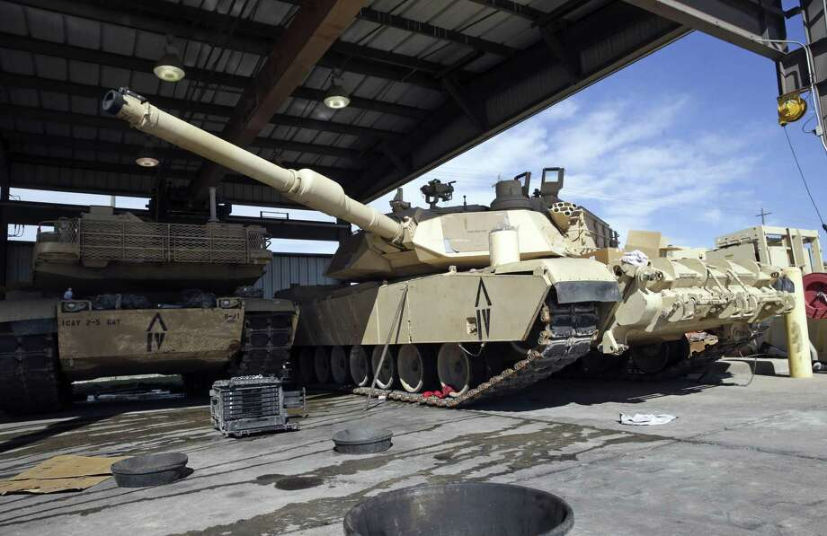 The size of the Abrams tank must be serviced in an outdoor facility due to its width preventing utilization of motor pool bays built for WWII vehicles as facilities at Fort Hood are sceduled for renovation on February 15, 2017. Photo: Tom Reel, Staff / San Antonio Express-News / 2017 SAN ANTONIO EXPRESS-NEWS