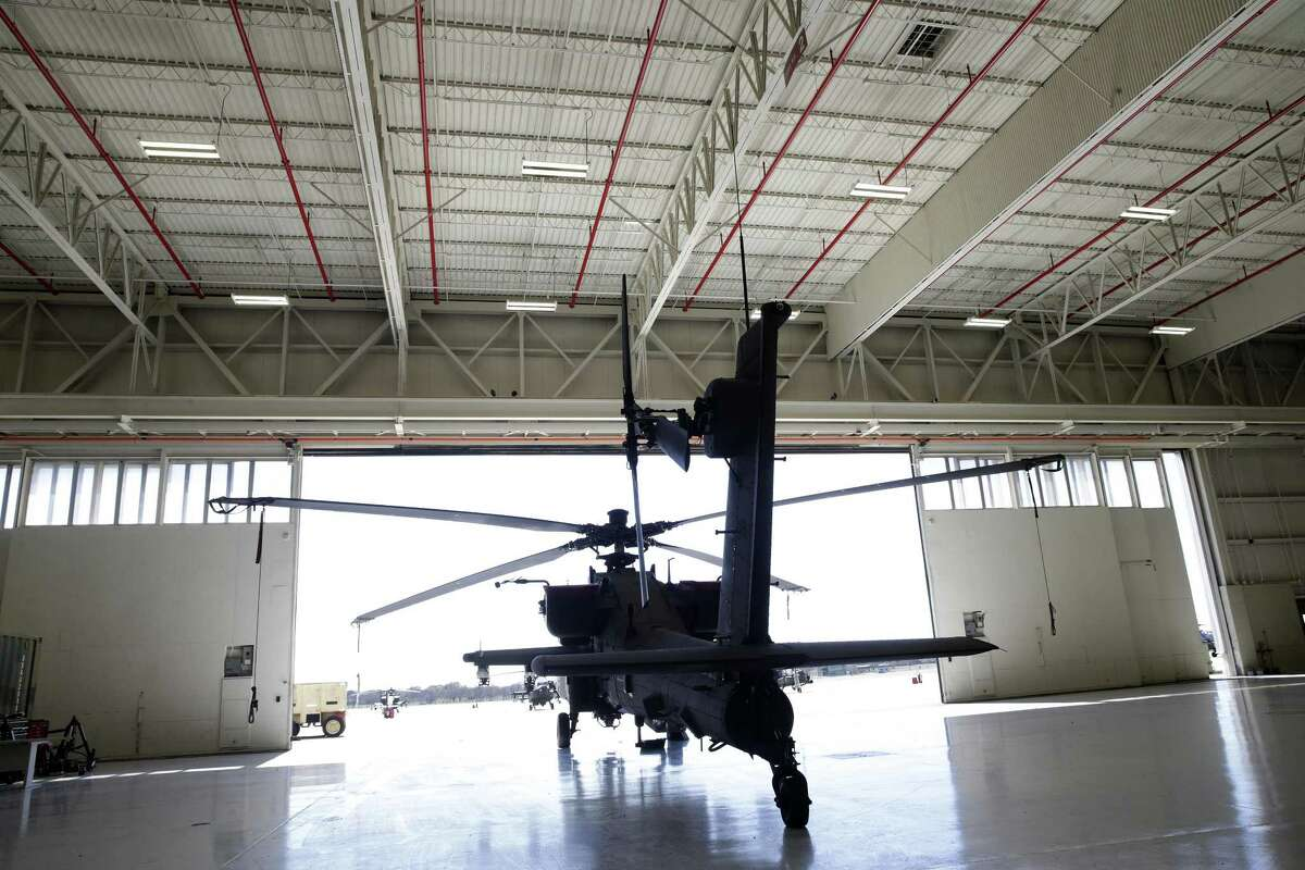 An Apache helicopter rests in an ancient hanger as facilities at Fort Hood are sceduled for renovation on February 15, 2017.