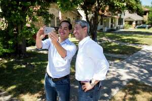 Former San Antonio Mayor Julian Castro takes a selfie with mayoral candidate Ron Nirenberg on Donaldson Avenue in San Antonio, Texas on May 13, 2017. Castro publicly endorsed Nirenberg on Saturday. Ray Whitehouse / for the San Antonio Express-News