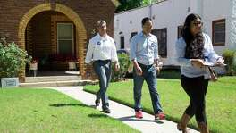 Former San Antonio Mayor Julian Castro visited San Antonio residents with mayoral candidate Ron Nirenberg and Juany Torres, deputy campaign manager, on Donaldson Avenue in San Antonio, Texas on May 13, 2017. Castro publicly endorsed Nirenberg on Saturday. Ray Whitehouse / for the San Antonio Express-News