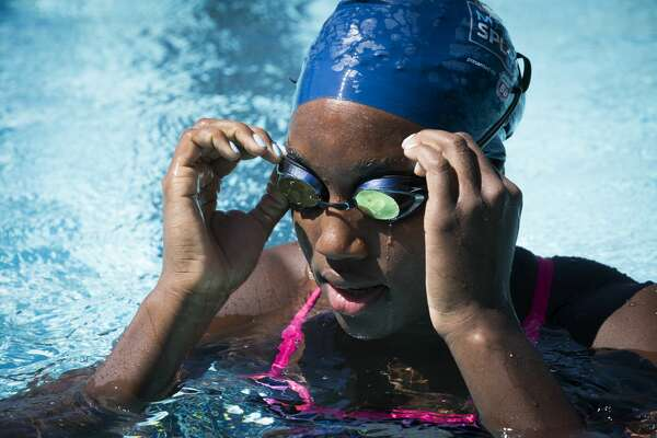 2016 Rio Olympics gold medalist, Simone Manuel adjusts her goggles during a visit to Houston to give swim lessons to children at the Dad's Club, Saturday, May 13, 2017, in Houston. ( Marie D. De Jesus / Houston Chronicle )