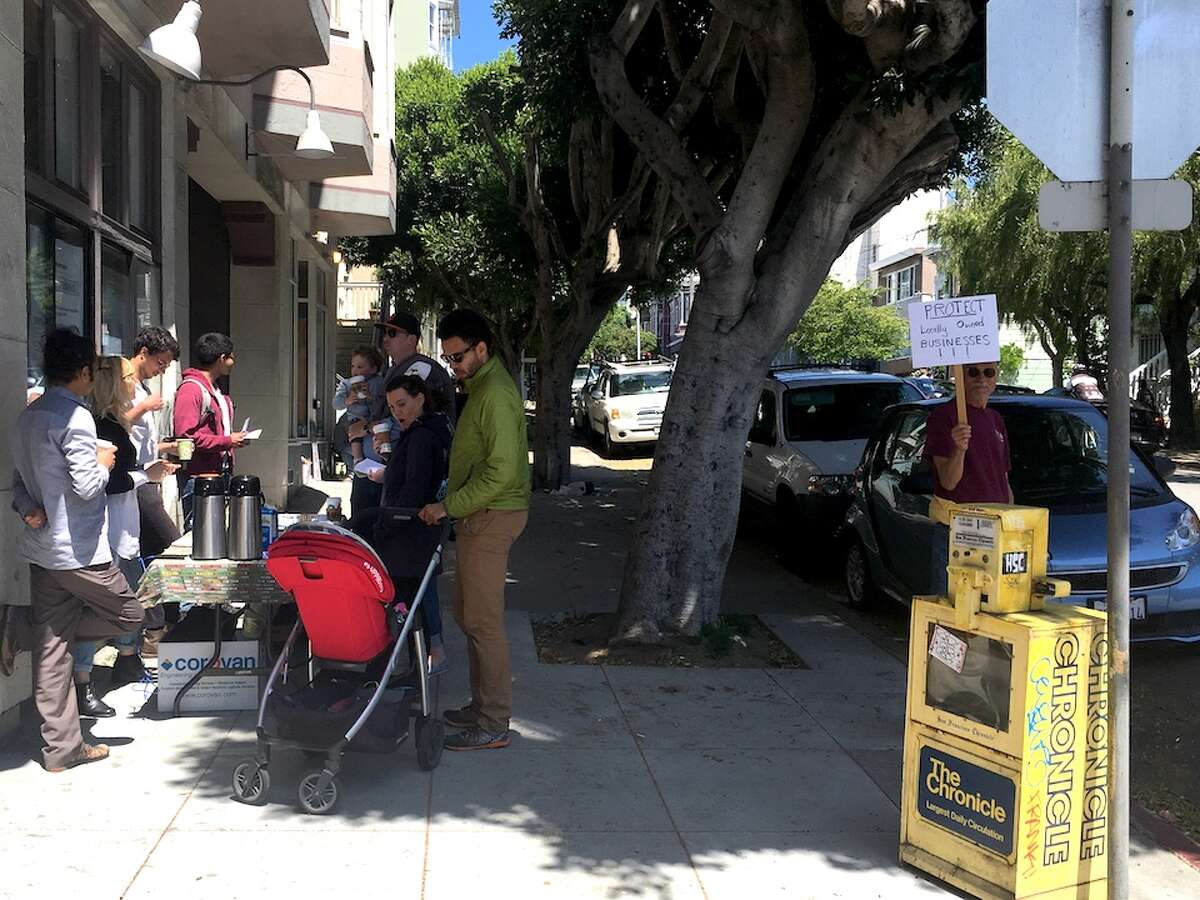 A protest against Blue Bottle moving into the 201 Steiner St. location.