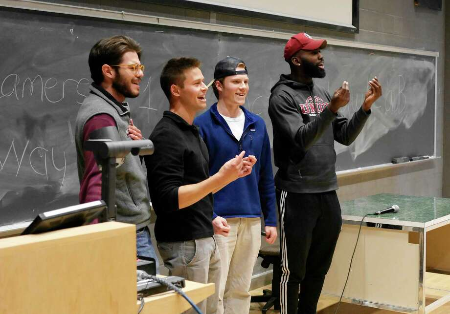 Union College students from left to right, Nico Suarez, Russell Kirschenbaum, Quinn McCarthy and Deshon Burgess sign a song as they pitch their charity organization, What Can Your Mom Do For You, in the Innovation, Creativity and the Entrepreneurial Mindset class on Wednesday, May 10, 2017, in Schenectady, N.Y.  The class held a backwards pitch competition on Wednesday where teams of students pitched an idea for a product or business going for the worst, most bizarre, most ridiculous ideas.  The What Can Your Mom Do For You charity would allow a student's mother to do things around campus to take money off of the student's tuition.  (Paul Buckowski / Times Union) Photo: PAUL BUCKOWSKI / 20040474A
