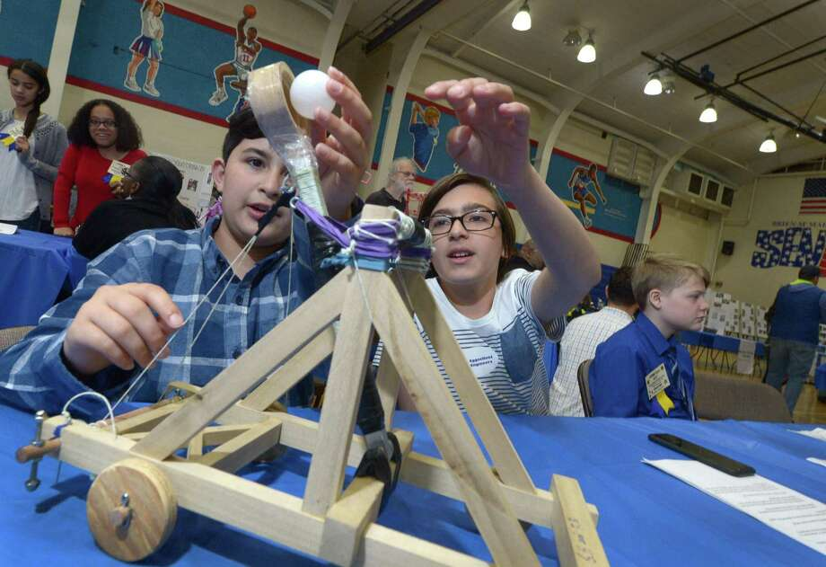 Ponus Ridge Middle School 6th graders Favian Quiroga and Gabriel Halatchev demonstrate their catapult project during the Norwalk Public Schools 2017 STEM Expo Saturday, May 13, 2017, at Brien McMahon High School in Norwalk, Conn. The Expo featured student winners from each school presenting their STEM projects, high school STEM demonstrations, and PreK students from Odyssey and ELLI classrooms presenting their individual STEM-based projects. Photo: Erik Trautmann / Hearst Connecticut Media / Norwalk Hour