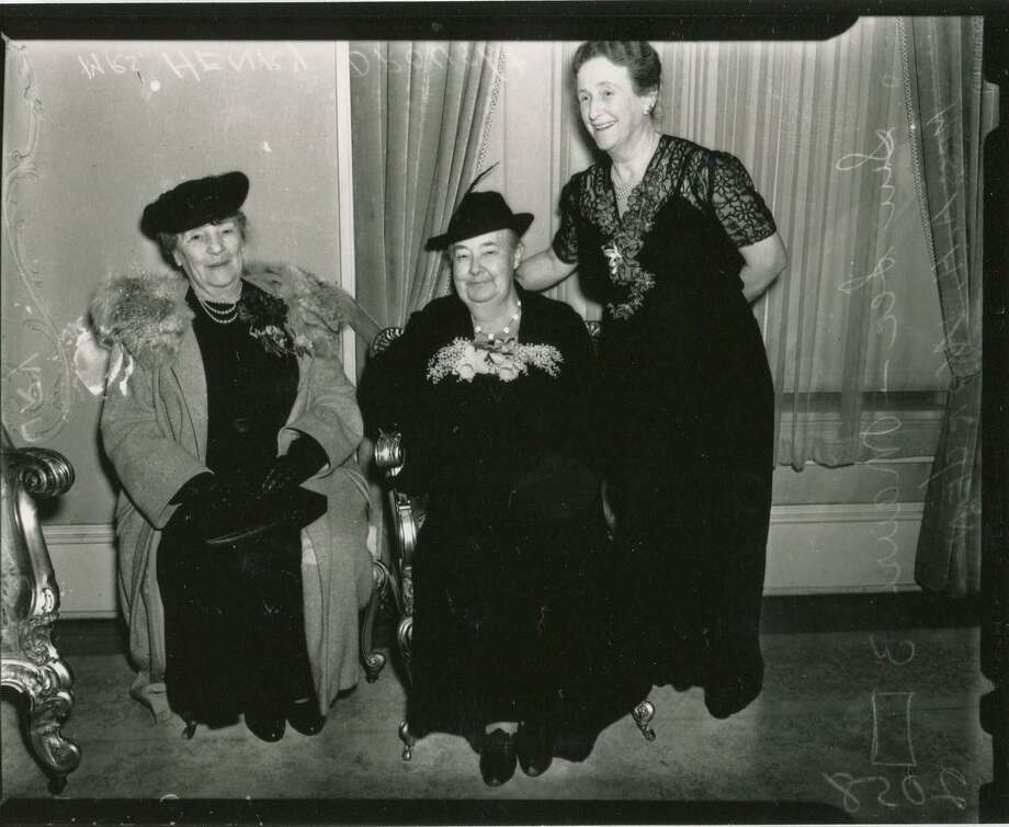 "Women at tea given by the Noontime Round Table of the Women's Club on ""Friendship Day."" Shown are (from left) Mrs. E.S. Maury, Mrs. Henry Drought, one of the founding members, and Mrs. A.H. Worden. Published in the San Antonio Light on March 12, 1939 Photo: UTSA Special Collections"