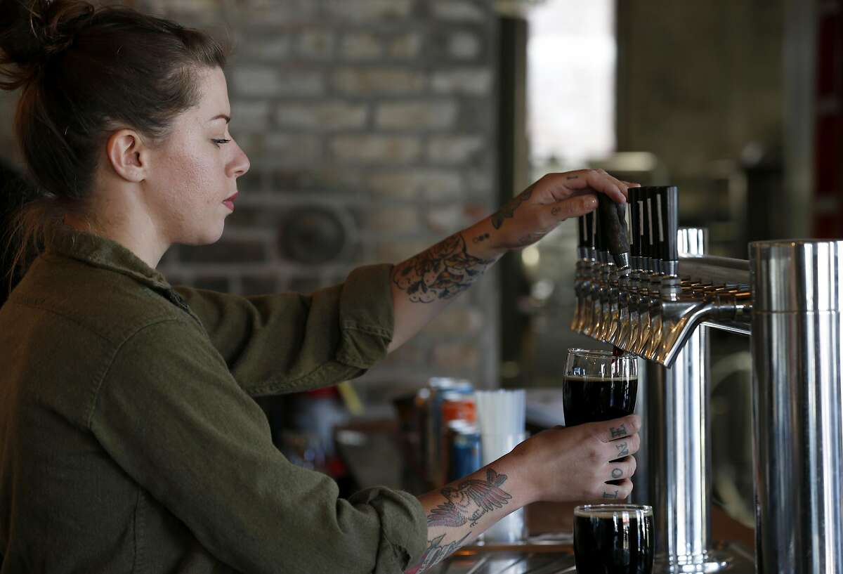 Katherine Quinn pours a pint at Old Kan Beer & Co. in Oakland, Calif. on Saturday, May 13, 2017.