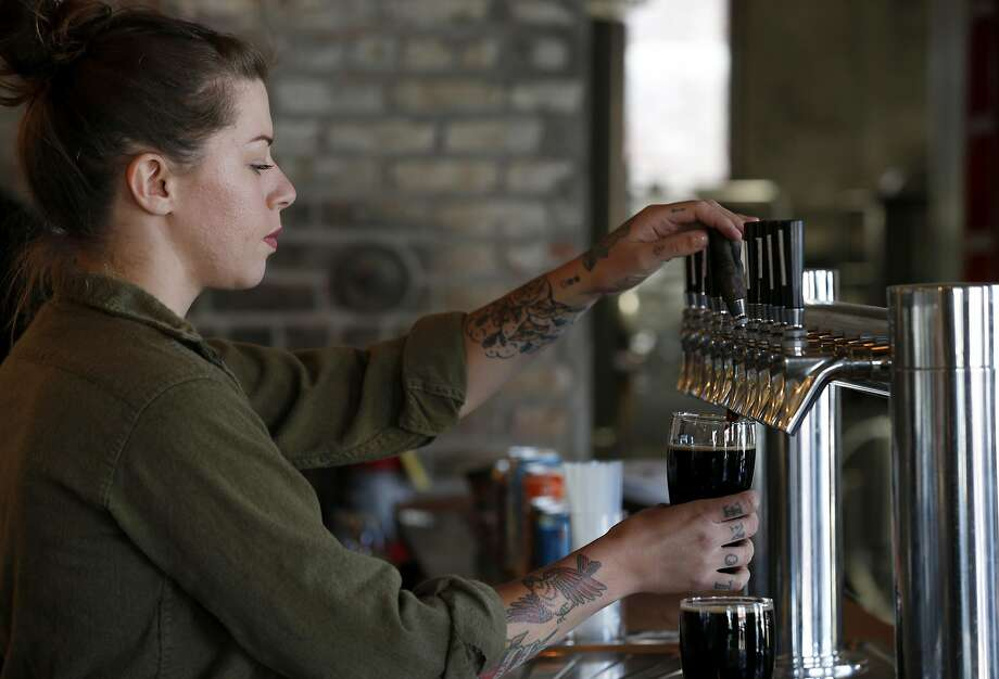 Katherine Quinn pours a pint at Adam Lamoreaux's Old Kan Beer & Co. on Linden Street in West Oakland. Photo: Paul Chinn, The Chronicle
