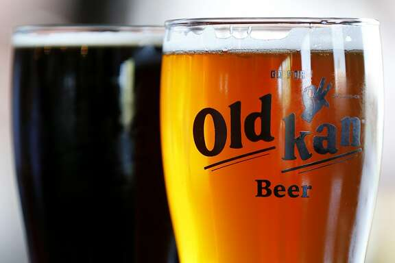 Pints of Old Kan dark and original beers are poured at Old Kan Beer & Co. in Oakland, Calif. on Saturday, May 13, 2017.