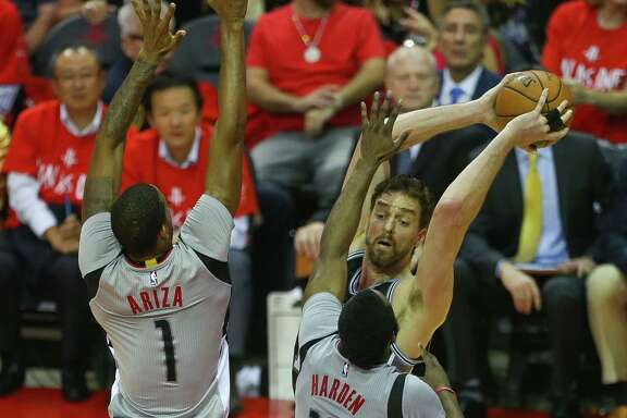 San Antonio Spurs center Pau Gasol (16) looks to pass past Houston Rockets forward Trevor Ariza (1) and guard James Harden (13) during the second half of Game 6 of the Western Conference semi-final series between the Houston Rockets and San Antonio Spurs at Toyota Center, Thursday, May 11, 2017, in Houston. (Mark Mulligan / Houston Chronicle)