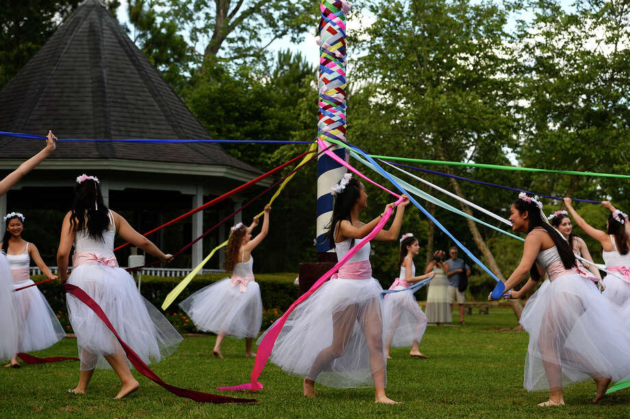 """Dancers with the Bonnie Cokinos School of Dance dance around the pole during the Maypole Festival at Tyrrell Park on Saturday. The annual festival is symbolic of new beginnings and held in memory of Paula """"Torchy"""" Salter, who passed away in 2010. Photo taken Saturday 5/13/17 Ryan Pelham/The Enterprise Photo: Ryan Pelham / ©2017 The Beaumont Enterprise/Ryan Pelham"""