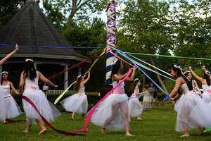 """Dancers with the Bonnie Cokinos School of Dance dance around the pole during the Maypole Festival at Tyrrell Park on Saturday. The annual festival is symbolic of new beginnings and held in memory of Paula """"Torchy"""" Salter, who passed away in 2010. Photo taken Saturday 5/13/17 Ryan Pelham/The Enterprise"""