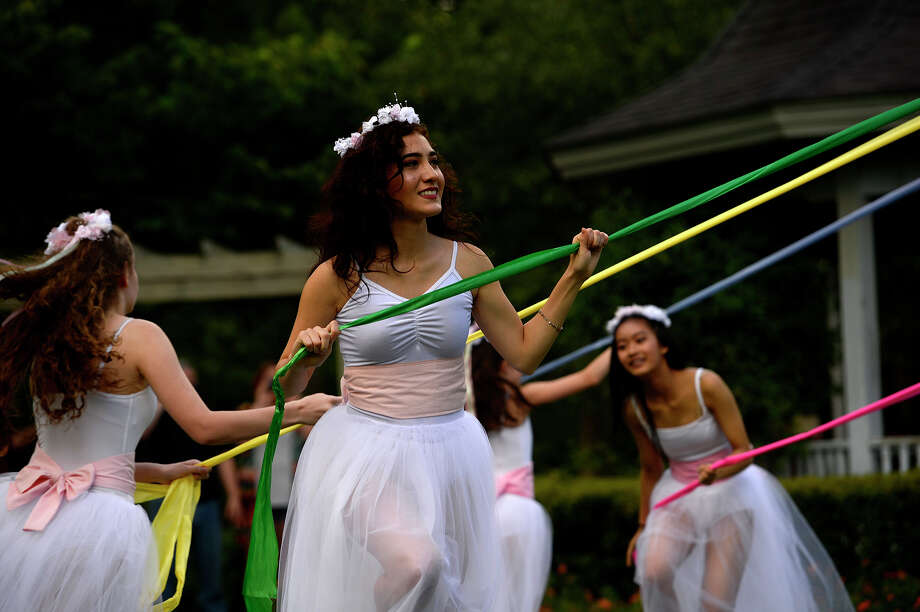 "Dancers with the Bonnie Cokinos School of Dance dance around the pole during the Maypole Festival at Tyrrell Park on Saturday. The annual festival is symbolic of new beginnings and held in memory of Paula ""Torchy"" Salter, who passed away in 2010. Photo taken Saturday 5/13/17 Ryan Pelham/The Enterprise Photo: Ryan Pelham / ©2017 The Beaumont Enterprise/Ryan Pelham"